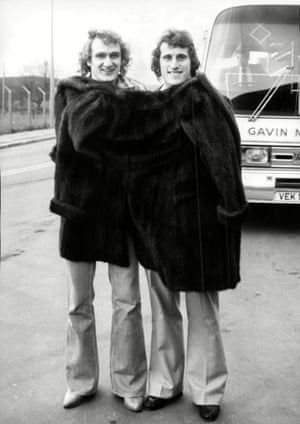 Liverpool's Phil Thompson, left, and Ray Clemence wrap up together in a fur coat