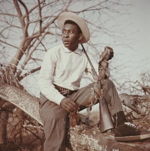 Pele holding a shotgun and a number of dead birds whilst on a shooting trip circa 1960.