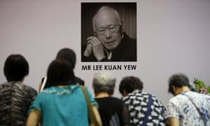 People bow as they pay their respects to the late former prime minister Lee Kuan Yew at Tanjong Pagar community club, Singapore.