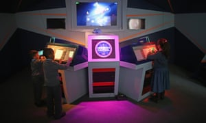 Children from St Joseph's School, Nottingham, try out Mission Control one of the new computer games at the arcade.
