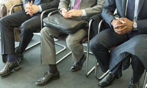 Businessmen sitting in waiting area