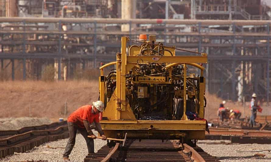 A workman hammers away at a railroad under construction at the Arco Polypropylene plant in Wilmington, California. Non-profits in the state are using new legislation to help clean up pre-production plastic pollution