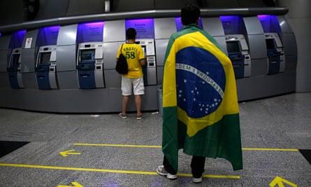Brazilians at an ATM machine