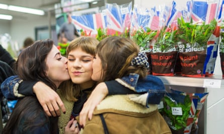 Students stage a kiss-in at a Sainsbury's store in Brighton last year after two gay women were threatened with ejection for kissing.