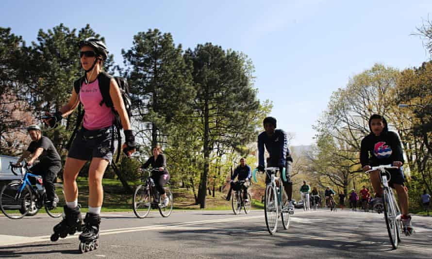 Cyclists, runners and skaters exercise around Central Park in New York.