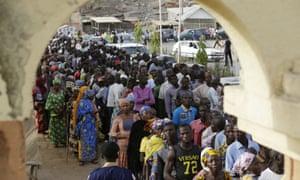 People queue to vote in the town of Yola in eastern Nigeria.