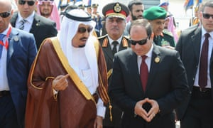 Abdel Fatah al-Sisi receives Saudi King Salman  upon his arrival ahead of the Arab Summit in Sharm el-Sheikh.