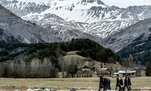 People arrive to pay tribute to the victims of the Germanwings flight that crashed in the French Alp