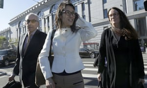 Ellen Pao, center, walks with attorneys Alan Exelrod, left, and Therese Lawless outside of Civic Center Courthouse in San Francisco on 27 March.