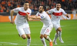 Turkey's Forward Burak Yilmaz (L) celebrates with teammates after scoring during the Euro 2016 qualifying round football match between Netherlands and Turkey at the Arena Stadium, on March 27, 2015 in Amsterdam. AFP PHOTO / JOHN THYSJOHN THYS/AFP/Getty ImagesFootballSoccer