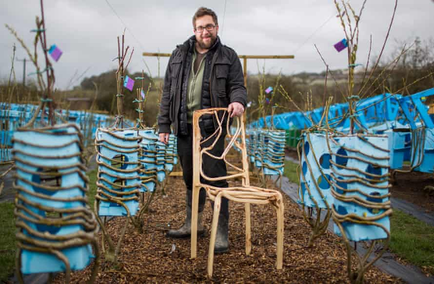 Gavin Munro, founder of Full Grown in Derbyshire, with a chair and moulds used to grow lampshades.