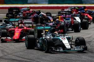 Hamilton leads into the first corner.