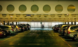 Cars lie parked in a line at the Milton Keynes Hospital multi-storey car park