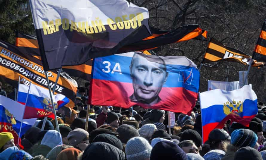 Protesters carry patriotic flags as they demonstrate against the production of Wagner's Tannhauser in Novosibirsk