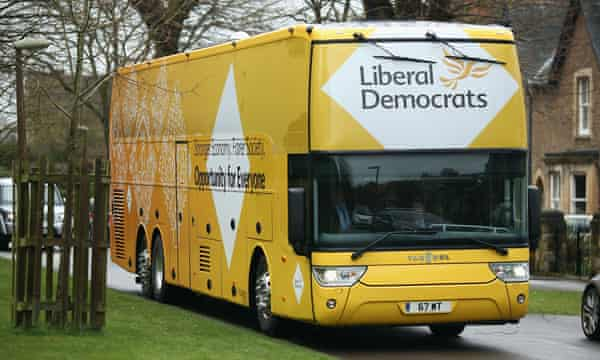 The Lib Dem battle bus boasts yellow mood lighting, a private booth for meetings and interviews, and a satellite radio transmitter.