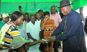 Incumbent president Goodluck Jonathan, right, is registered to vote in Otuoke, his home town, on Saturday.
