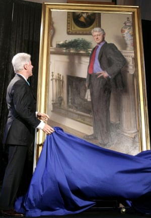 Bill Clinton looking up at his portrait