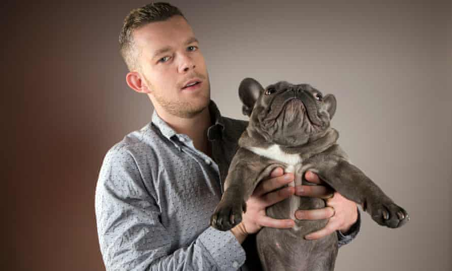 Russell Tovey poses with his french bulldog, named Rocky