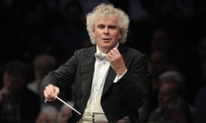 Sir Simon Rattle conducts the Berlin Philharmonic at the 2012 BBC Proms at the Royal Albert Hall in London.