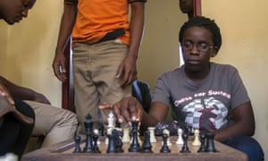 Phiona Mutesi, now 18, plays chess with her colleagues at the chess academy in Kibuye, Kampala.