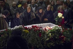 Relatives and friends stand beside Nemtsov's coffin.