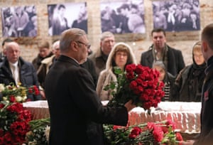 RPR-Parnas party co-chairman Mikhail Kasyanov holds roses