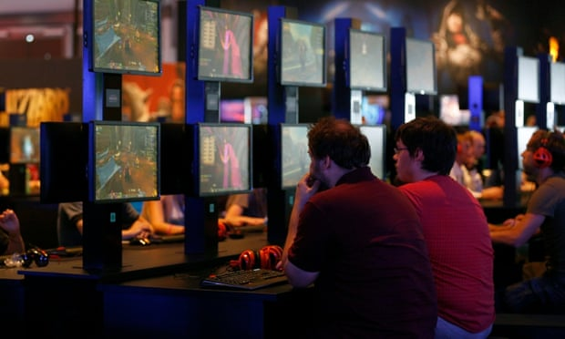 Visitors play World of Warcraft at the Blizzard Entertainment exhibition stand during the Gamescom 2014 fair in Cologne.