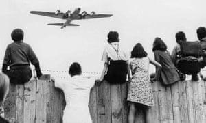 West Berlin children at Tempelhof airport watch fleets of U.S. airplanes bringing in supplies