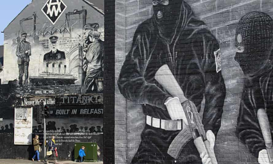 Contrasting murals depict the Titanic and gunmen in the Loyalist Newtownards Road area (see History of Terror, Belfast). Photograph: Peter Morrison/AP