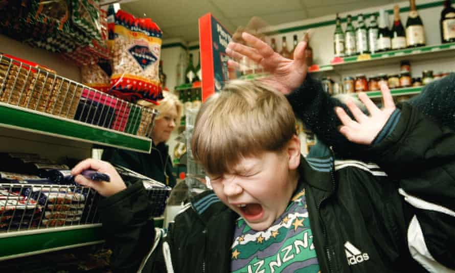 Smacking a child in a supermarket (posed by model).