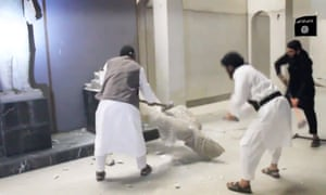 Islamic State jihadists destroy ancient artefacts in the Mosul museum.