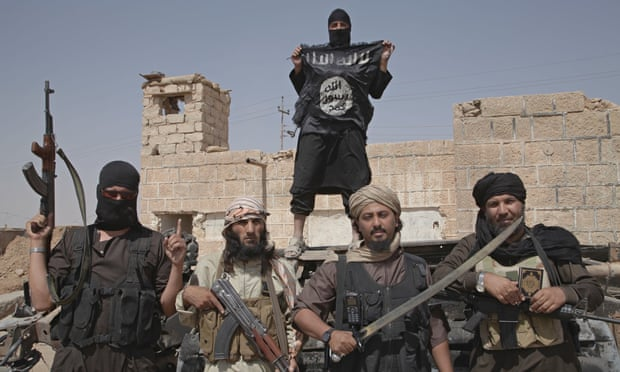 Isis fighters on the border of Syria and Iraq