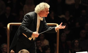 Simon Rattle conducts the Berlin Philharmonic at the Barbican, London, in 2011.