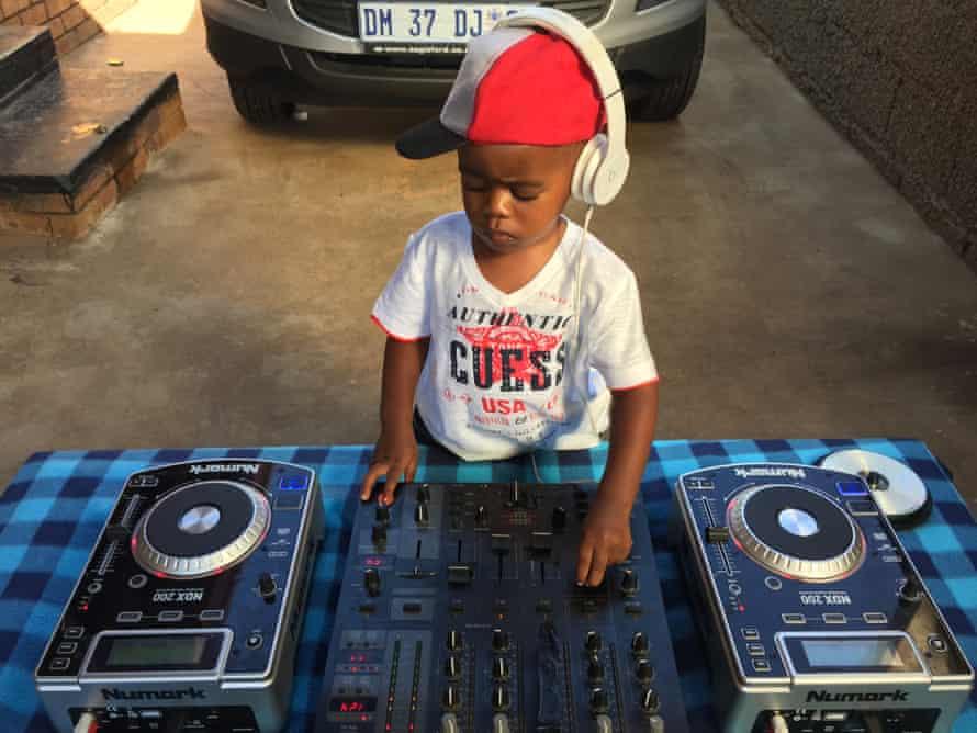 DJ Arch Jr, aged 2, mixes the decks