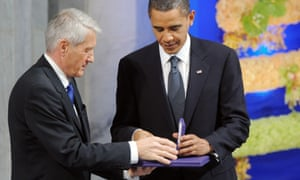 Thorbjørn Jagland handing the Nobel peace prize diploma and medal to Barack Obama – a decision that angered many Norwegians.