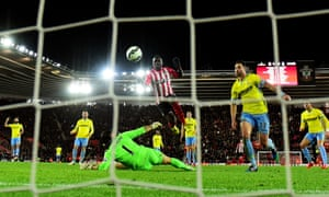 Sadio Mané of Southampton lifts the ball over Crystal Palace goalkeeper Julian Speroni to score the only goal of their Premier League match at St Mary's.