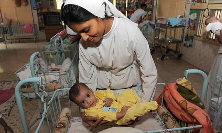 Orphaned Indian baby with nun