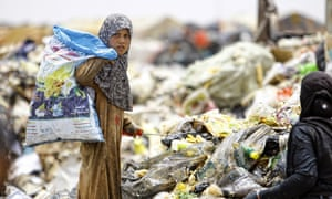 Iraq and Afghanistan accounted for 22% of all official development assistance (ODA) sent to fragile states and economies … an Iraqi girl searches through rubbish for recyclable items, Najaf, central Iraq.