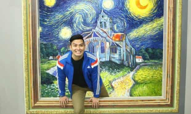 a visitor to Manila's Art in Island selfie museum enjoys an intimate moment with Van Gogh.