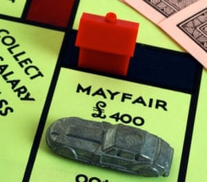 The car on Mayfair in a game of Monopoly, with a red hotel