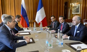 The Russian foreign minister, Sergei Lavrov (L), and members of his delegation during Iran nuclear talks.