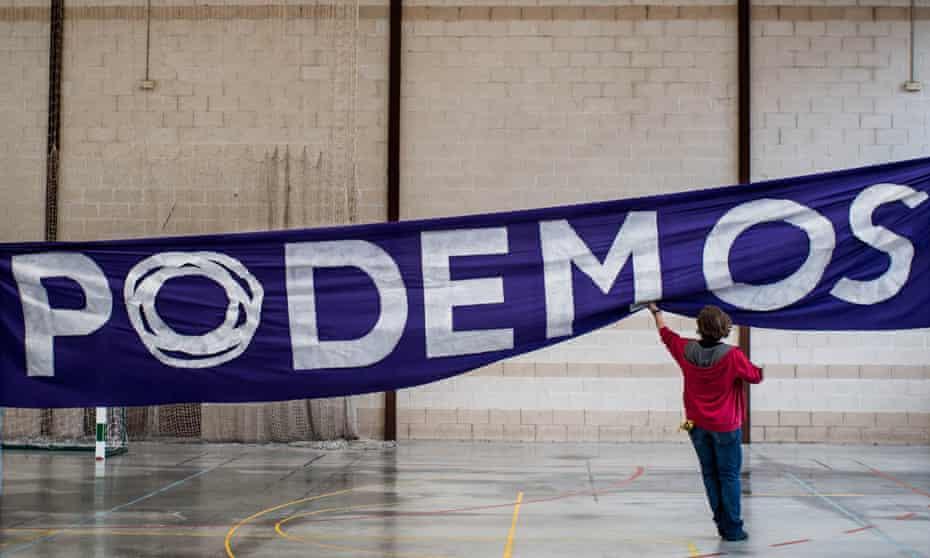 a Podemos political party banner being put up in Spain