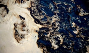 Toxic waste in a tailing pond at the Syncrude open pit oil excavation mine in Fort McMurray