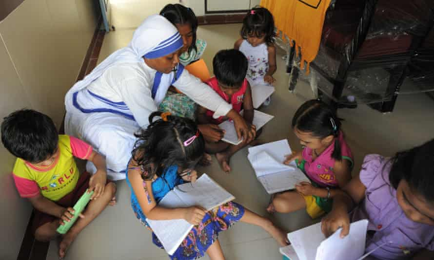 nun with orphans in Ahmedabad
