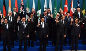 """US President Barack Obama (2nd R) waves with other world leaders as they take part in the G20 """"family photo"""" during the G20 Summit in Brisbane on November 15, 2014. Australia is hosting the leaders of the world's 20 biggest economies for the G20 summit in Brisbane on November 15 and 16. AFP PHOTO / Saeed KHANSAEED KHAN/AFP/Getty Images"""