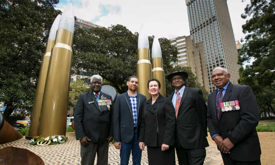 Anzacs David Williams, Pastor Ray Minnniecon and Harry Allie along with artist Tony Albert (second left) and lord mayor Clover Moore, stand in front of Yininmadyemi Thou Didst Let Fall.