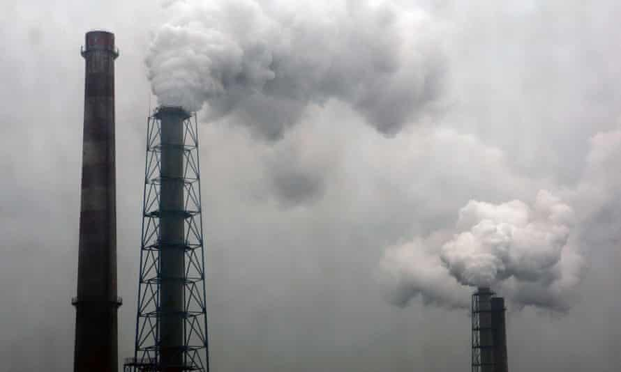 Smoke billows from chimneys of a steel plant on a hazy day in Hangzhou, Zhejiang province, China