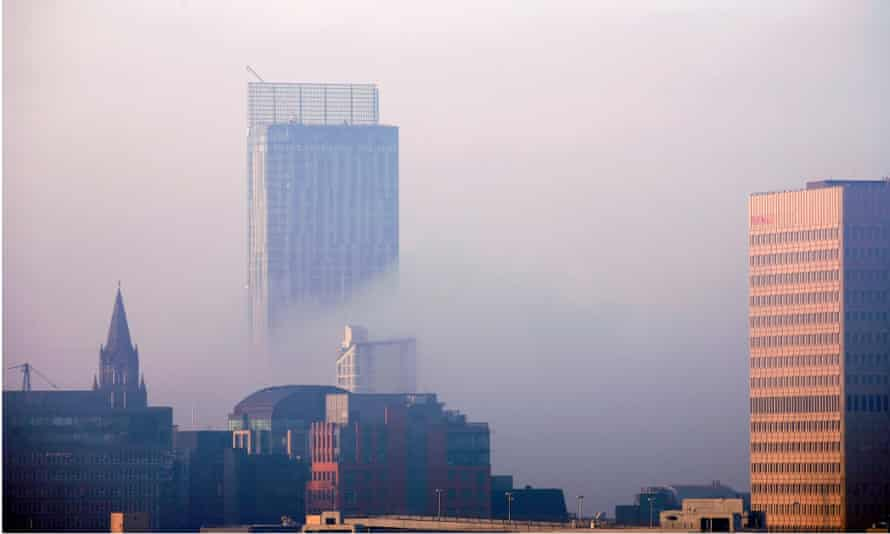 Beetham Tower peeping out of the dawn mist on the Manchester city centre skyline.