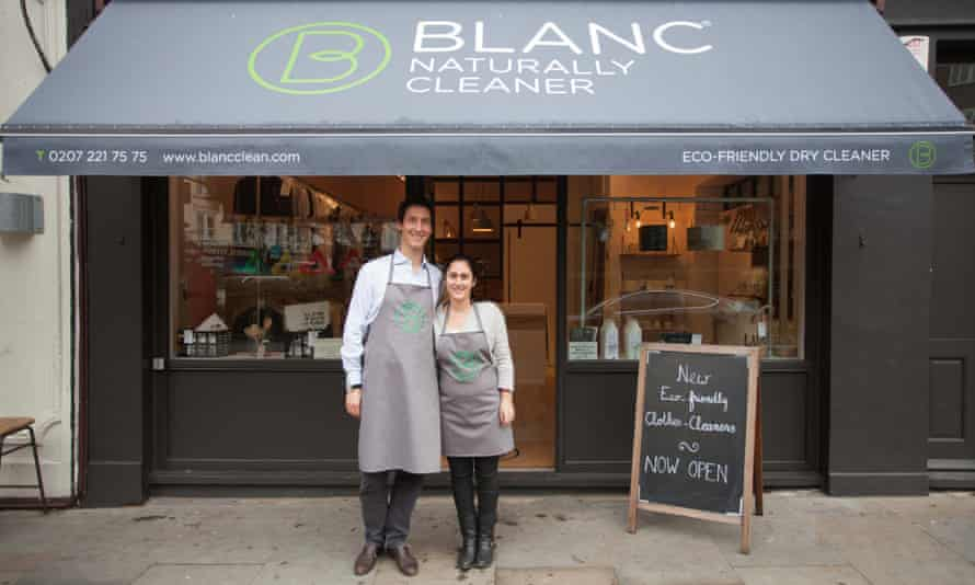 Ludovic Blanc and Mathilde in aprons under the awning of Blanc, their eco dry cleaning business
