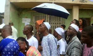 People wait to vote at an election centre in Lagos